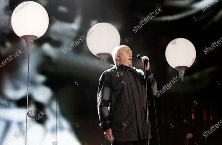 """British singer Peter Gabriel performs the song """"heroes"""" during the central event to commemorate the Fall of the Wall at the Brandenburg Gate in Berlin, Germany on . Gabriel turns 71 on Feb. 13"""