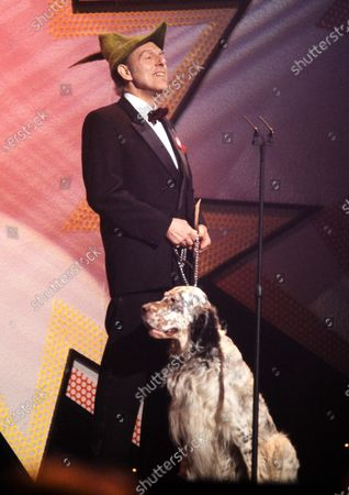 Stock Photo of Maurice Oberstein with dog - Brit Awards 1992