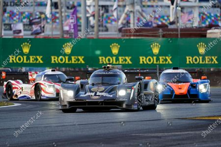 Series driving team of Tristan Vautier, Loic Duval and Sebastien Bourdais (5) leads a group of cars through the infield road course during the Rolex 24 hour auto race at Daytona International Speedway, in Daytona Beach, Fla