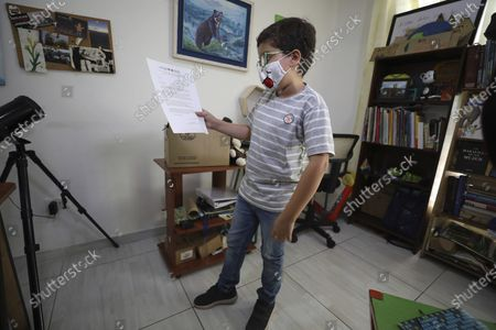 Francisco Vera, well-known in Colombia for his environmental campaigns and defense of children's rights, shows a letter that Michelle Bachelet, UN High Commissioner for Human Rights, sent to him in Villeta, Colombia, . The 11-year-old is a famous environmentalist and children's' rights activist in Colombia, where he leads a group called Guardians for Life