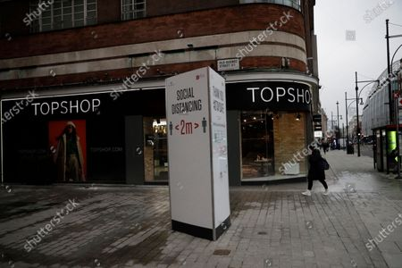 Woman wearing a face mask to curb the spread of coronavirus walks past a closed brach of Topshop and a social distancing sign where Old Quebec Street joins Oxford Street, in London, during England's third national lockdown since the coronavirus outbreak beganOnline fashion seller Asos has bought Topshop, which once boasted designs by Kate Moss and Beyonce, along with three other brands for 265 million pounds ($363 million) as rivals scoop up bargains after the collapse of Britain's Arcadia retail group. The deal, announced Monday, puts thousands of jobs at risk because Asos acquired the Topshop, Topman, Miss Selfridge's and HIIT brands but none of their stores