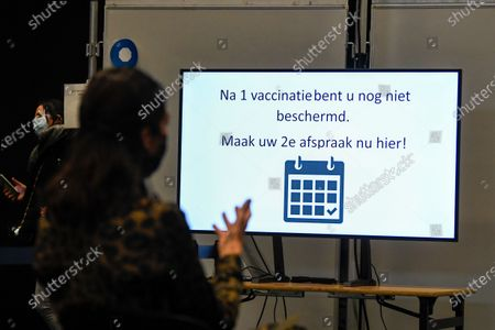 Stock Image of Visit of Flemish minister Bart Somers to the first dry run in a Flemish vaccination center . Today the test run starts at the De Kimpel vaccination center in Bilzen. Together with fifty volunteers and extras, a so-called dry run is organized to see where there are still problems. Among other things, the flow of visitors is examined. The Flemish scripts will be adjusted on the basis of the test runs in various vaccination centers.