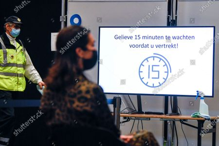 Stock Picture of Visit of Flemish minister Bart Somers to the first dry run in a Flemish vaccination center . Today the test run starts at the De Kimpel vaccination center in Bilzen. Together with fifty volunteers and extras, a so-called dry run is organized to see where there are still problems. Among other things, the flow of visitors is examined. The Flemish scripts will be adjusted on the basis of the test runs in various vaccination centers.