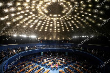 Stock Photo of General view of the Plenary of the Senate during the vote for Parliament, in the National Congress, in Brasilia, Brazil, 01 February 2021. The renewal of the Parliament's directive may reinforce the pressures for an impeachment against President Bolsonaro or bury them almost definitively, which is what the Government is strongly committed to. The launch of a process with a view to the dismissal of a ruler depends, according to the country's Constitution, on the president of the Chamber of Deputies, a position that until now has been held by the center-right opponent Rodrigo Maia, who leaves almost 70 requests for impeachment against Bolsonaro pending a response.