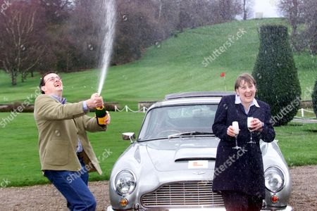 Peter Mallett (37) And His Partner Julie Costello (27) Who Won 11 7 Million On The National Lottery Pictured With An Aston Martin Db6 At Moor Park Golf Club