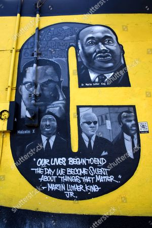 Martin Luther King, Malcolm X are seen on the mural. Black History month is celebrated during the month of February in the United States. The mural depicts black people in history that made an impact during the 20th and 21st century.