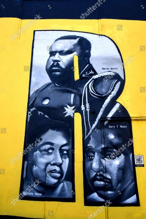 Marcus Garvey, Harriette Moore and Harry T. Moore.  Black History month is celebrated during the month of February in the United States. The mural depicts black people in history that made an impact during the 20th and 21st century.