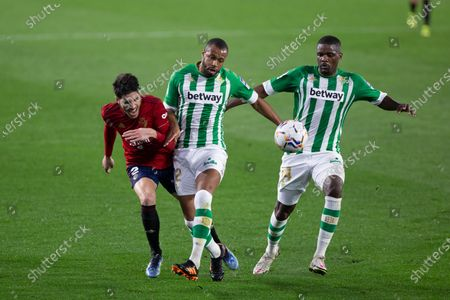 Stock Picture of Juan Cruz of Osasuna, William Carvalho of Real Betis  and Sidnei Rechel of Real Betis during LaLiga, football match played between Real Betis Balompie and Club Atletico Osasuna de Vigo at Benito Villamarin Stadium on February 1, 2021 in Sevilla, Spain.