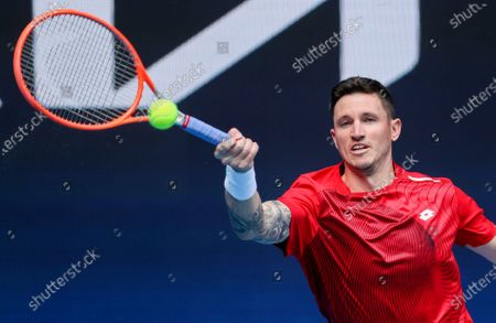 Austria's Dennis Novak makes a forehand return to Italy's Fabio Fognini during their ATP Cup match in Melbourne, Australia