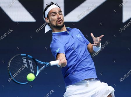 Italy's Fabio Fognini makes a forehand return to Austria's Dennis Novak during their ATP Cup match in Melbourne, Australia