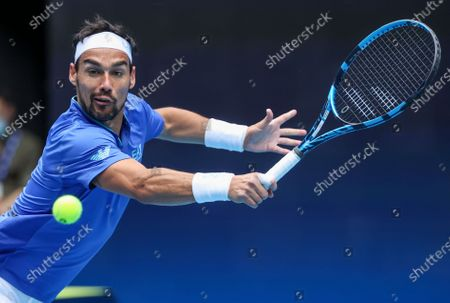 Italy's Fabio Fognini makes a backhand return to Austria's Dennis Novak during their ATP Cup match in Melbourne, Australia