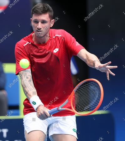 Austria's Dennis Novak makes a backhand hand return to Italy's Fabio Fognini during their ATP Cup match in Melbourne, Australia