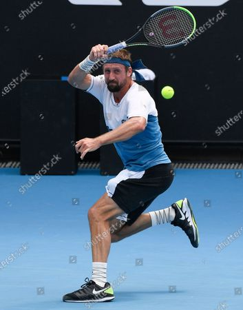 United States' Tennys Sandgren makes a forehand return to Australia's John-Patrick Smith at a tuneup tournament ahead of the Australian Open tennis championships in Melbourne, Australia
