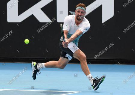United States' Tennys Sandgren makes a backhand return to Australia's John-Patrick Smith at a tuneup tournament ahead of the Australian Open tennis championships in Melbourne, Australia