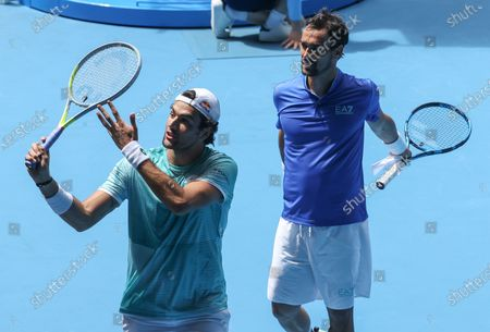 Stock Image of Italy's Matteo Berritini, left, and Fabio Fognini celebrate after defeating Austria's Dennis Novak and Dominic Thiem during their ATP Cup match in Melbourne, Australia