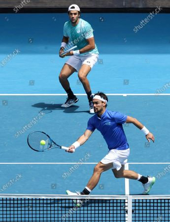 Stock Photo of Italy's Matteo Berritini, top left, and Fabio Fognini in action against Austria's Dennis Novak and Dominic Thiem during their ATP Cup match in Melbourne, Australia