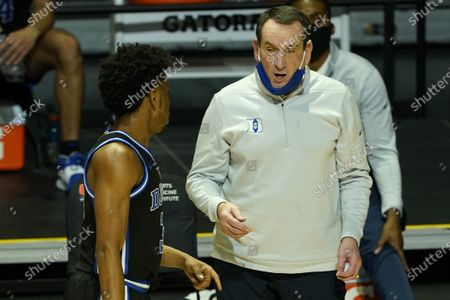 Stock Picture of Duke head coach Mike Krzyzewski talks to guard Jeremy Roach (3) during the second half of an NCAA college basketball game against Miami, in Coral Gables, Fla