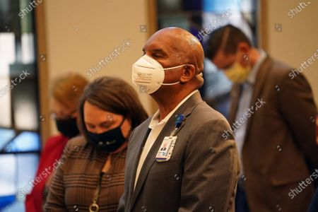 "SSM Health, St. Louis University Hospital President Steven Scott, listens to a prayer during ""Celebrating the Beloved Community"", kicking off Black History Month at St. Louis University Hospital in St. Louis"