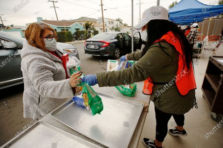 Editorial picture of Los Angeles Unified will reach a milestone in its nation-leading food-relief effort at schools, providing 100 million meals, along with 18 million items of much-need supplies, to students and families in need. Supt. Austin Beutner will mark the occasion by
