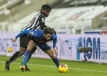 Andros Townsend of Crystal Palace shields the ball from Allan Saint-Maximin of Newcastle United; St James Park, Newcastle, Tyne and Wear, England; English Premier League Football, Newcastle United versus Crystal Palace.