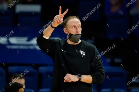Stock Image of Illinois State head coach Dan Miller directs his team during the first half of an NCAA college basketball game against Drake, in Des Moines, Iowa