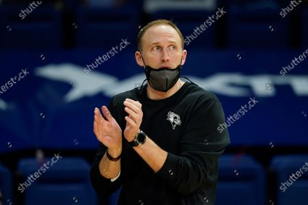 Stock Picture of Illinois State head coach Dan Miller applauds his team during the first half of an NCAA college basketball game against Drake, in Des Moines, Iowa