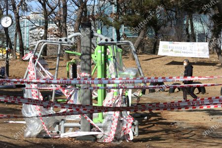 Banned public sports facilities are taped off according to social distancing rules at a park in Goyang, South Korea