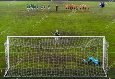 Harry Anderson of Lincoln City looks dejected as his penalty hits row Z during the shootout