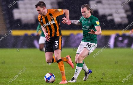 Callum Elder of Hull City and Harry Anderson of Lincoln City