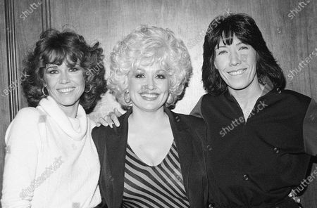"Stock Picture of Jane Fonda, from left, Dolly Parton and Lily Tomlin get together Dec. 12, 1980 at a Los Angeles news conference to promote their movie ""9 To 5"". Parton's 1980's hit song ""9 to 5"" has been flipped by Squarespace, the company that helps users build and host their own websites, for a Super Bowl commercial debuting . Oscar winner Damien Chazelle of ""La La Land"" fame directed the spot"
