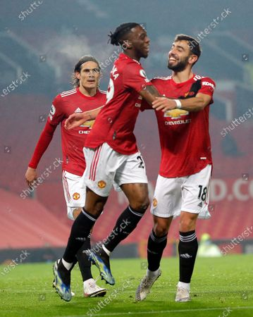 Aaron Wan-Bissaka of Manchester United puts the ball in the net past Goalkeeper Alex McCarthy of Southampton…cele with Edison Cavani on Manchester United and Bruno Fernandes of Manchester United