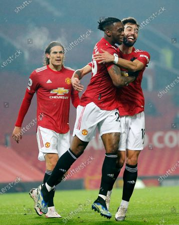 Aaron Wan-Bissaka of Manchester United puts the ball in the net past Goalkeeper Alex McCarthy of Southampton...cele with Edison Cavani on Manchester United and Bruno Fernandes of Manchester United