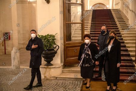 """Italia Viva"""" party leader Matteo Renzi, left, and his delegation, from left, Teresa Bellanova, Davide Faraone, and Maria Elena Boschi, leave the Rome's Quirinale presidential palace after meeting Italian President Sergio Mattarella. The political parties that make up caretaker Premier Giuseppe Conte's collapsed government kept up their squabbling over key policy issues, including European Union pandemic aid, as they struggle to give birth to what would be a revived coalition. President Mattarella has set Tuesday Feb. 2, 2021 as the deadline for a progress report"""