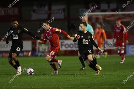 Crawley Town's Tom Nichols is challenged by  Tristan Abrahams and Orient's Dan Kemp  during Sky Bet EFL  league 2 match between Crawley Town and Leyton Orient at the People's Pension  Stadium in Crawley.