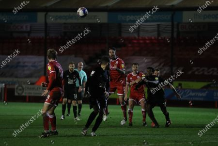 Crawley Town's Joe McNerney  and Crawley Town's Tony Craig wait for a cross during Sky Bet EFL  league 2 match between Crawley Town and Leyton Orient at the People's Pension  Stadium in Crawley.
