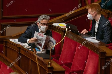 Alexis Corbiere and Adrien Quatennens with a magazine with Melenchon on cover