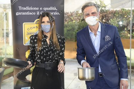 Elisabetta Gregoraci and Beppe Convertini wearing masks hold cooking pans during the Dispensa Stellata fourth edition event. Esposizioni Restaurant at Exposition Palace, the fourth edition of the format against food waste promoted by the Consorzio Zampone and Cotechino Modena IGP. It presents a new, tasty and original recipes, ideal for disposing of the pantry but with a touch of creativity and a nod to the EU legislation against food waste.