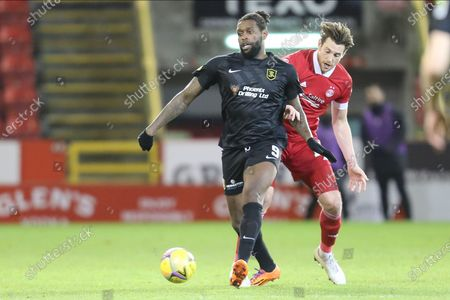 Aberdeen defender Ashton Taylor (14) and Jay Emmanuel-Thomas (9) of Livingston battles for possession, tussles, tackles, challenges, during the Scottish Premiership match between Aberdeen and Livingston at Pittodrie Stadium, Aberdeen