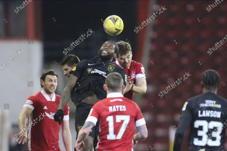Aberdeen defender Tommie Hoban (3) and Jay Emmanuel-Thomas (9) of Livingston battles for possession, tussles, tackles, challenges, heads the ball, aeriel challenge during the Scottish Premiership match between Aberdeen and Livingston at Pittodrie Stadium, Aberdeen