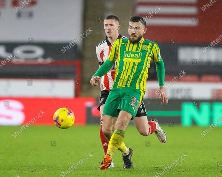 Robert Snodgrass of West Bromwich Albion is pressured by  John Lundstram of Sheffield United