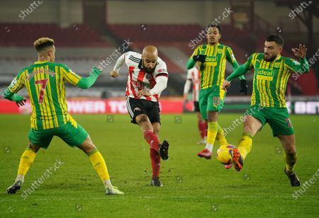 David McGoldrick (C) of Sheffield in action against Callum Robinson (L) and Robert Snodgrass (R) of West Bromwich during the English Premier League soccer match between Sheffield United and West Bromwich Albion in Sheffield, Britain, 02 February 2021.