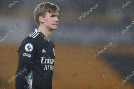 Stock Image of Arsenal's goalkeeper Runar Alex Runarsson walks in after he replaced Arsenal's goalkeeper Bernd Leno during the English Premier League match between Wolverhampton Wanderers and Arsenal at the Molineux Stadium in Wolverhampton, England