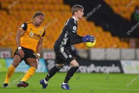 Arsenal's goalkeeper Runar Alex Runarsson, right, holds the ball as Wolverhampton Wanderers' Adama Traore reacts during the English Premier League match between Wolverhampton Wanderers and Arsenal at the Molineux Stadium in Wolverhampton, England