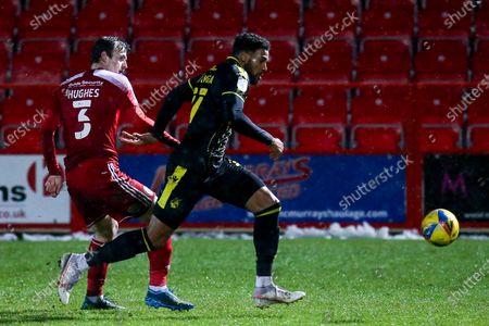 Jonah Ayunga of Bristol Rovers takes on Mark Hughes of Accrington Stanley