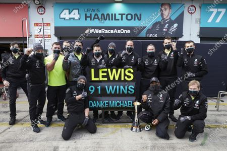 NYRBURGRING, GERMANY - OCTOBER 11: Lewis Hamilton, Mercedes-AMG Petronas F1, 1st position, and the Mercedes team celebrate after securing 91 race wins for Lewis, equalling the record of Michael Schumacher during the Eifel GP at NYrburgring on Sunday October 11, 2020, Germany. (Photo by Steve Etherington / LAT Images)