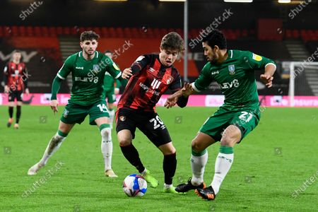 Stock Picture of Rodrigo Riquelme (20) of AFC Bournemouth battles for possession with Massimo Luongo (21) of Sheffield Wednesday during the EFL Sky Bet Championship match between Bournemouth and Sheffield Wednesday at the Vitality Stadium, Bournemouth