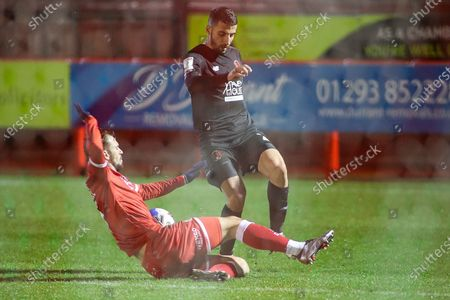 Crawley Towns Jack Powell tackles Leyton Orients Andy Thompson   during the EFL Sky Bet League 2 match between Crawley Town and Leyton Orient at The People's Pension Stadium, Crawley