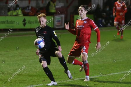 James Brophy of Leyton Orient shields the ball from Crawleys  Tom Nichols  during the EFL Sky Bet League 2 match between Crawley Town and Leyton Orient at The People's Pension Stadium, Crawley