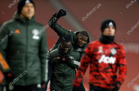 Manchester United's Paul Pogba, centre top, and Eric Bailly during the warm up before the English Premier League soccer match between Manchester United and Southampton, at the Old Trafford stadium in Manchester, England