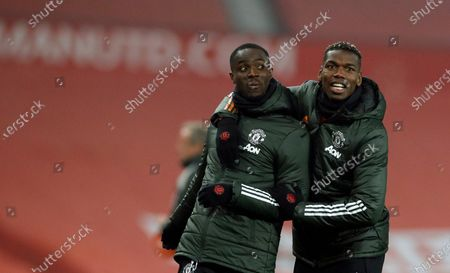 Manchester United's Paul Pogba, right, and Eric Bailly during the warm up before the English Premier League soccer match between Manchester United and Southampton, at the Old Trafford stadium in Manchester, England
